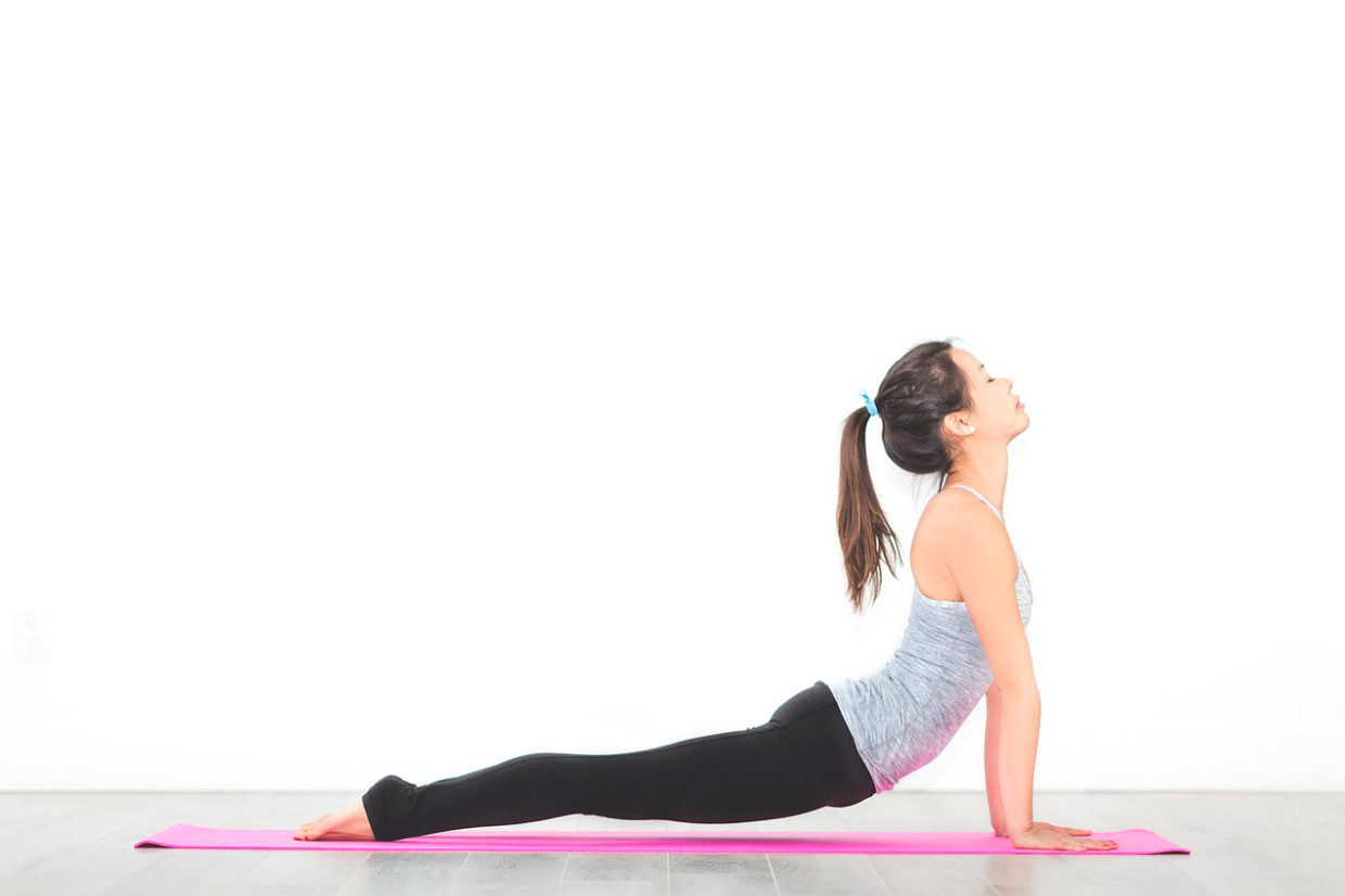 Woman doing backs and legs excercises