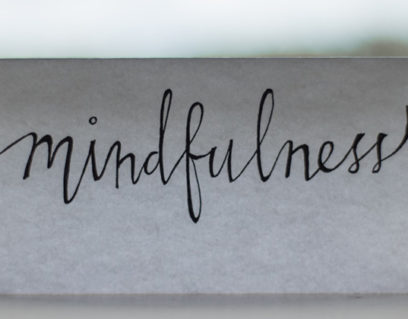 A with paper in front of the window with mindfulness print