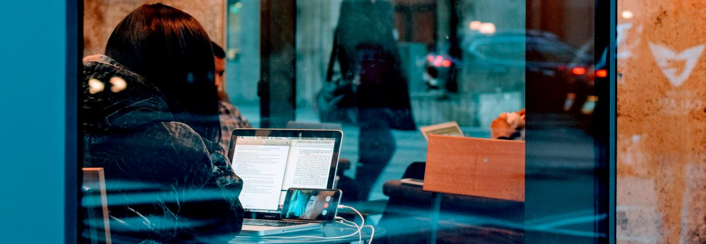 A woman during a videocall in a coffee shop
