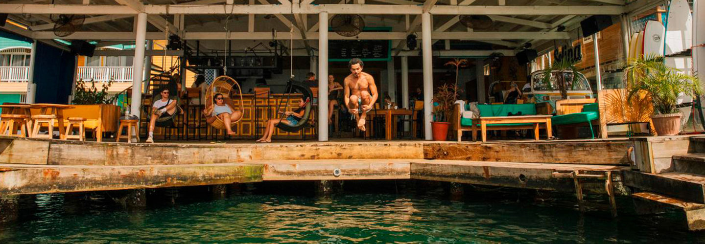Photo of a guy jumping at Selina Bocas del Toro one of the coolest coworking around the world