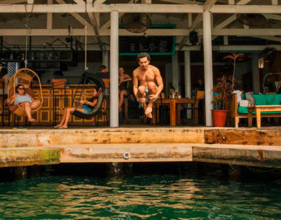 Phot of a guy jumping at Selina Bocas del Toro one of the coolest coworking around the world
