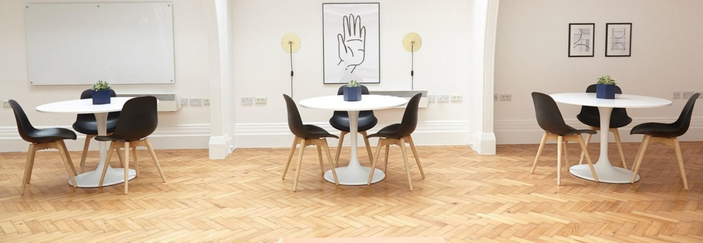 Bright office space with paintings and chairs