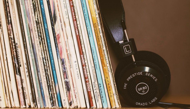 vintage disks and headphone on a shelf