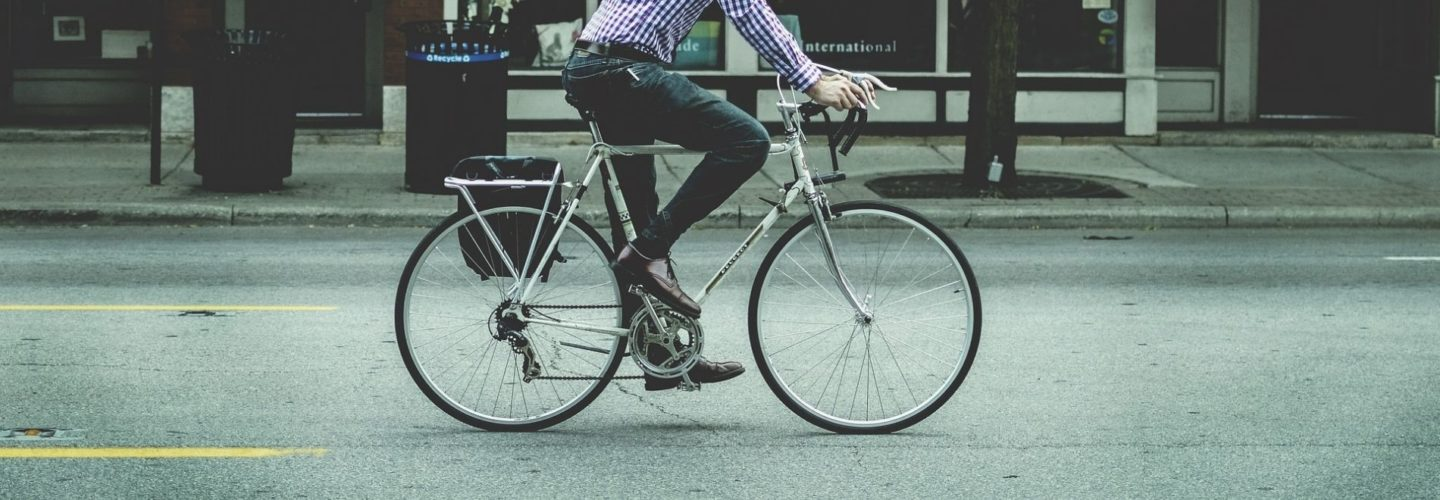 A man on his bicycle in the city